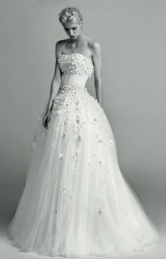 Stunning strapless flower covered wedding dress with tulle ballgown skirt; Featured Dress: Viktor & Rolf 2017