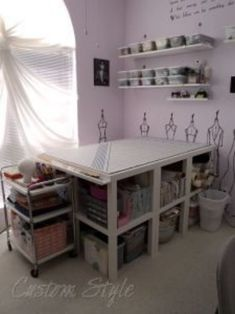 How I Organized My Sewing Room - A different Ikea hacked cutting table made out of 12 side tables! Ikea Sewing Rooms, Sewing Spaces, My Sewing Room, Fabric Cutting Table, Cutting Tables, Sewing Room Organization, Craft Room Storage, Storage Shelves, Craft Rooms