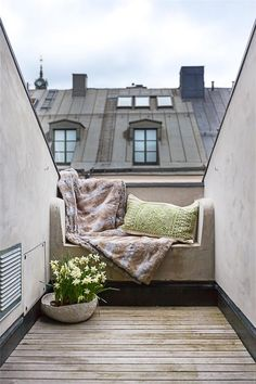 Great use of an urban roofttop space: Bedroom balcony in a penthouse in Östermalm - a city district in Stockholm, Sweden.