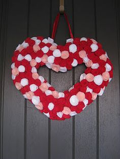 super cute Valentine's wreath made from felt roses.  Great step by step.  (from A Baker's House)