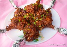 Drums of Heaven is a one of the various methods of preparing chicken lollipop in Indo Chinese Cuisine where the chicken lollipop is tossed in schezwan sauce.