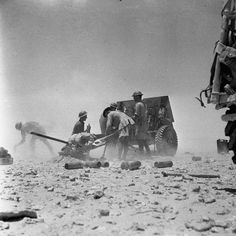 A 25-pdr field gun of 11th Field Regiment, Royal Artillery, in action during the First Battle of El Alamein, July 1942.