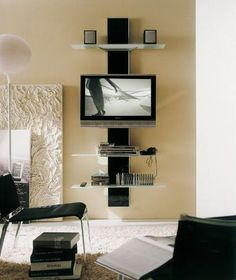 A TV mount with multiple shelves saves space in a small living room. It also helps you keep all your media needs stored in one spot.