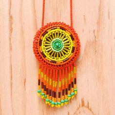 Vintage Psychedelic Beaded Dreamcatcher Necklace - Southwestern Boho Hippie Necklace. $46.00, via Etsy.