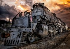 """Twenty-five Big Boys were built exclusively for Union Pacific Railroad, the first of which was delivered in 1941. The locomotives were 132 feet long and weighed 1.2 million pounds. Because of their great length, the frames of the Big Boys were """"hinged,"""" or articulated, to allow them to negotiate curves. They had a 4-8-8-4 wheel arrangement, which meant they had four wheels on the leading set of """"pilot"""" wheels which guided the engine, eight drivers, another set of eight drivers, and four…"""