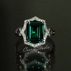 Start your happily ever after on a sweet note with this unique flower engagement ring set from Camellia Jewelry. Scrupulously handmade in fine detail, it is an white gold ring set that will show her how much you care without breaking the bank. White Gold Rings, Silver Rings, Emerald Jewelry, Emerald Rings, Ruby Rings, Diamond Rings, Gold Jewellery, Silver Jewelry, Vintage Jewellery