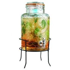 Serve crisp lemonade or sweet sangria in rustic-chic style with this charming beverage dispenser, featuring a honeycomb-inspired motif and rooster detail.  Product: Beverage dispenserConstruction Material: Ceramic and metalColor: ClearFeatures: 1.5 Gallon capacitySpout for easy pouring