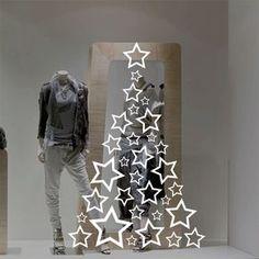 Vinilo decorativo Árbol de estrellas, ideal para decorar de una manera muy elegante un escaparate o una pared esta Navidad.
