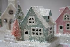 You can find these same houses at Hobby Lobby, ready to paint and dust with glitter.