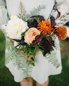 These ladies carried small bouquets of dahlias, umbrella ferns, geranium foliage, caramel Antike garden roses, ranunculus, thistle, sea grass, and plum foliage.