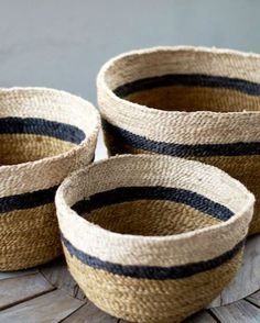 set of 3 baskets in gradient sizes: 3 color horizontal stripes: natural, dark navy (possibly black?) and a lighter natural/beige color.