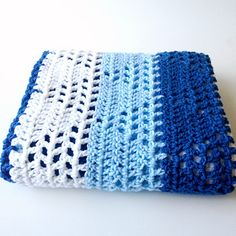A pattern for a baby blanket (approx 30x33 inches) that has a triangle pattern in striped rows. Can easily be made bigger or smaller. The pattern was inspired by a Japanese crochet pattern, a link to the chart can be found on the same post with the pattern.