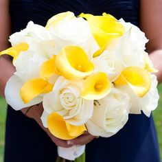 The maid of honor bouquets were a beautiful blend of Janessa's bouquet of white roses and the bridesmaids' bouquets of yellow calla lilies.