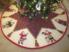 Beautiful Susan Roberts tree skirt finished by  Sign of the Arrow.