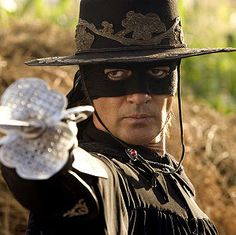 The most famous masked man, Zorro, as brought to life by Antonio Banderas in The Legend of Zorro. (The film was the sequel to The Mask of Zorro. Zoro, A Mascara Do Zorro, Halloween Legends, The Legend Of Zorro, The Mask Of Zorro, First Superhero, The Lone Ranger, Cinema, Les Themes
