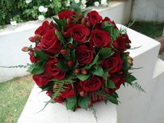 red roses, berries, ruscus and fern bouquet