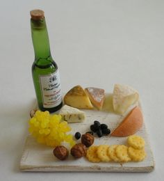 miniature cheese and wine...wine bottle neck seems a little off