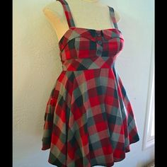 Red and black plaid circle skirt dress Very sweet plaid circle skirt dress with buttons on bust. Great for fall! Forever 21 Dresses