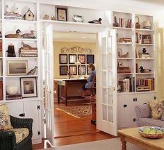 All Wall Collections and books can take up a lot of space. House them comfortably in wall-to-wall bookcases that surround a doorway or window. This would be great for our tv room /den - bookshelves to go around the french doors Bookshelf Door, Bookshelves Built In, Built Ins, Bookshelf Ideas, Book Shelves, Bookcases, Book Storage, Storage Ideas, Library Shelves
