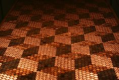 This DIY tabletop shimmers with an intricate design of 5,218 pennies