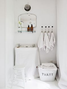 Love this simple, beautiful laundry area. Just what's needed for the job with style.  No excessive décor needed. © Carina Olander Photography