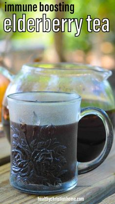 This elderberry tea is the best thing to sip when you feel a cold or virus coming on. Elderberry is proven to strengthen the immune system and support the entire body. I'm showing you 2 easy ways to make it - with dried elderberries OR re-using elderberries after you make elderberry syrup. #elderberry #elderberries #elderberryrecipes #elderberrytea  #tea #tearecipe #coldremedies #cold #coldremedies #coldremediesfastfeelbetter