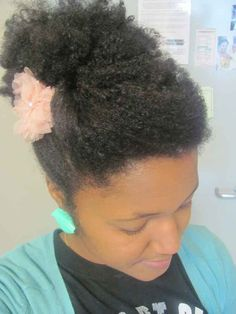 Updo with Flower   20 Natural Hairstyles To Combat Summer Heat And Humidity