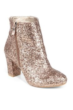 I just have a pair, slightly different, like this one. I love to wear them. Sparkly is not only for Christmas time :)