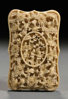 Ivory Card Case, China, 19th century, finely carved and pierced reserve with a courtyard scene surrounded with branching flowers, reverse carved in low relief with scholars engaged in pleasant pursuits, lg. 4 in.