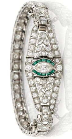 An art deco diamond and synthetic emerald bracelet, circa 1925 estimated total diamond weight: 3.00 carats; mounted in platinum.