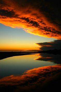 Sunset after the rain by loretta valdez