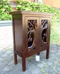 This is a custom cabinet, carved of solid mango wood.  www.GreatRoomFurn.com