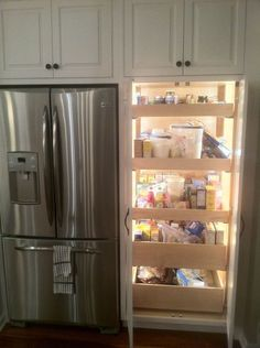 Lighted Pantry with pull out drawers ~ genius.