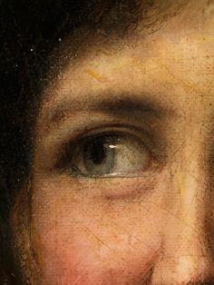 Brustbild einer jungen Frau vom Land mit leicht nach rechts gedrehtem Oberkörper, den Kopf nach links gedreht und nach links mit einem freundlichen Lächeln ...
