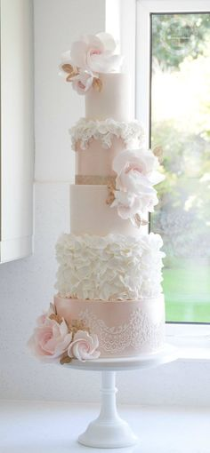 Gorgeous light pink fiver tier wedding cake with white and pink floral details; Featured Cake: Cotton and Crumbs