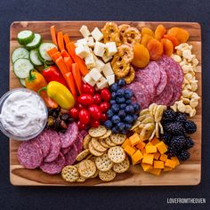 Kid friendly charcuterie board - homemade dried fruit, beetroot dip, flax crackers, etc.