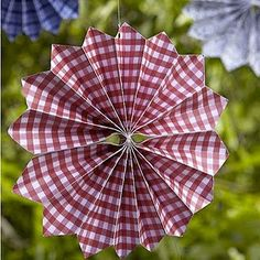 Cute pinwheels from scrapbook paper and to with fishing line in the middle.