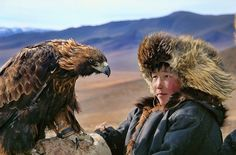 The Dukha train golden eagles to aid in their hunting. | A Lost Mongolian Tribe Was Rediscovered By A Photographer