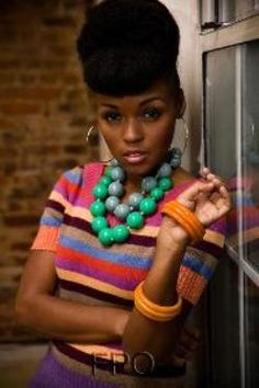 Janelle Monae,I wish she continues to wear more color.Shes made her point,too beautiful for just black and white.