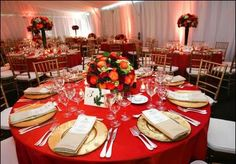 anothe red tableclothes with gold plates