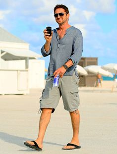 Clad in flip-flops, Gerard Butler takes a stroll in Miami's South Beach.