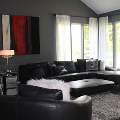 love the black furniture and grey walls the white accents lighten it up Living Room RedBlack