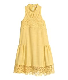 Bring some sunshine this summer in a light yellow A-line dress with stand-up collar, back opening, and lace trim. | H&M Pastels
