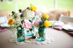Vintage blue mason jars centerpiece.