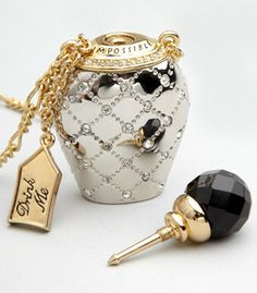 Disney Couture Drink Me Necklace- this is what the man of my dreams gave me for our first Christmas (2013)