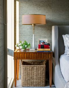 Don't be afraid to mix textures. Here, grasscloth wallpaper meets an antique wood nightstand and upholstered bed. #kathykuohome