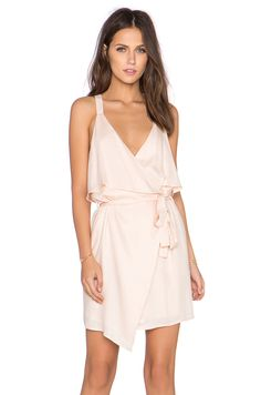 Lucca Couture x REVOLVE Ruffle Front Wrap Dress in Blush, about $125 CAD from REVOLVE