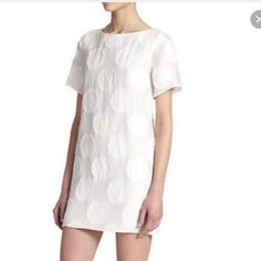 Alice & Olivia A line dress. A line dress in white with large polka dots pattern. Fully line, rayon & polyester blend.  Measures: 16 in at the chest, length: 33in from the shoulder. Alice + Olivia Dresses Mini