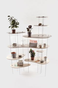 "Moscow based design studio Dopludo Collective created Nenuphar – gorgeous modular shelving.""  review uses word 'exiguous'"