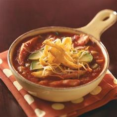 Best Chicken Tortilla Soup Recipe -Chock-full of veggies and autumn color, this soup is ideal for using up fresh garden bounty. Add richness by first grilling the chicken and vegetables. —Kathy Averbeck, Dousman, Wisconsin